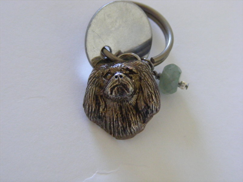 Pekingese with Green Aventurine crystal and dog tag